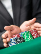 """Poker player going """"all in"""" pushing his chips forward"""
