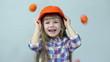 Orange rain. At the head of child falling tangerines.