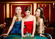 Three women bet playing roulette at the gambling house