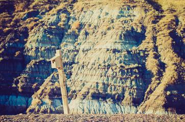 Bird house on barbwire wire fence - Drumheller Alberta - LOMO