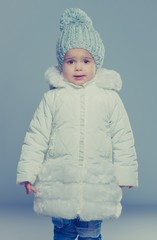 Funny little girl in winter coat
