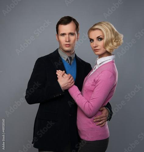 Elegant couple isolated on grey background