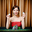 Woman with chips sitting at the roulette table