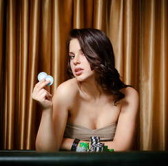 Portrait of female gambler sitting at the roulette table