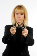 Female executive holding scissors representing corporates cuts