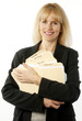 Attractive female office worker holding file folders