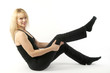 Blond woman doing yoga stretching exercise