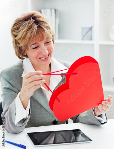 Businesswoman with red heart present