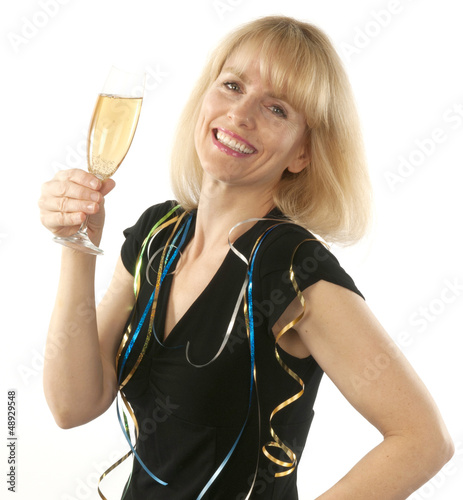 Woman celebrating with a glass of champagne