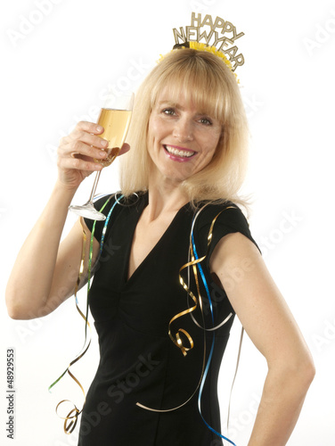 Woman celebrating with champagne New Year's Eve
