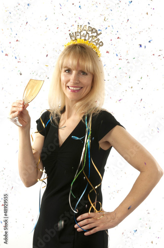 Woman celebrating with a glass of champagne on New Year's Eve