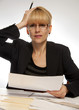Stressed female executive office hand on head
