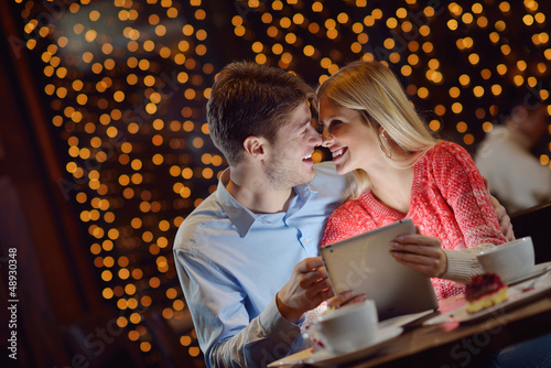 young couple with a tablet computer