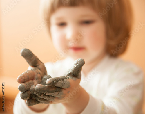 Little girl modelling clay toy