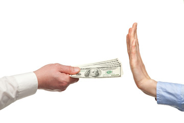 Human hands rejecting an offer of money