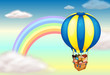 A hot air balloon near the rainbow
