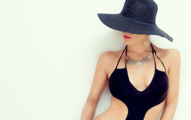 fashion portrait of a sensual girl in a bathing suit