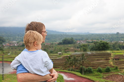 father and son in rice fields of Bali