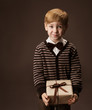 Child holding gift box. Vintage style. Funny looking