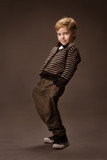 Happy Boy dancing over brown background. Vintage style.