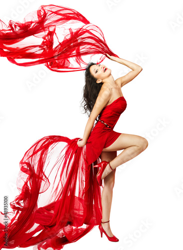 Woman  in red dress dancing with fabric flying on a wind flow.