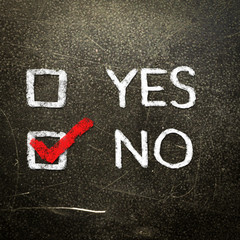 Yes or no written on the blackboard with white chalk. Your choic