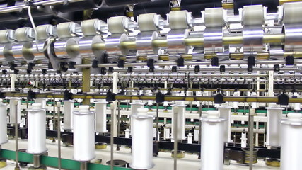automated production of synthetic fibers