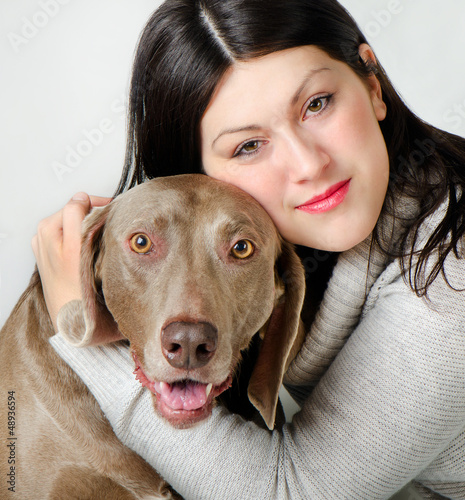 Young beautiful  woman with dog