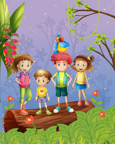 Children with one colorful parrot in the forest