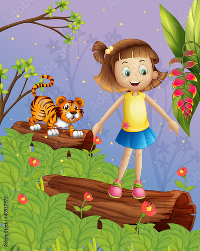 A girl and a tiger in the forest