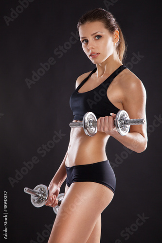 Sporty woman with dumbbells