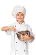 Happy little Chef girl with ladle girl having fun making cookies