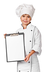 Beautiful kid chef holding a notice board over a white backgroun