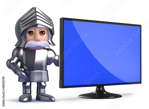 Knight stands by a widescreen monitor