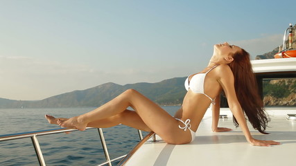Bikini Woman Enjoying Charter Yacht Vacation