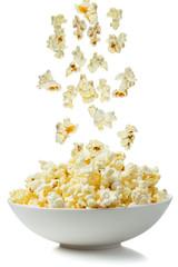 Popcorn falling in a bowl