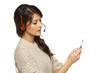 Smiling cheerful woman in headset with cellphone