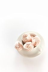 Pink Meringues in a white cup