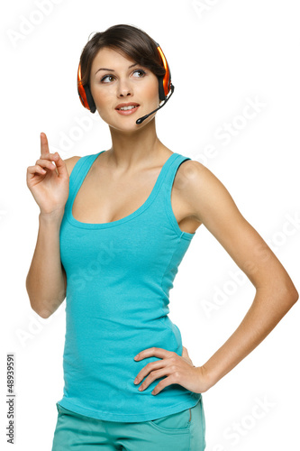 Pensive female in headset with finger up