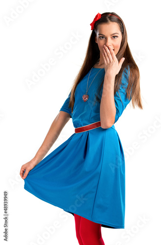 Cute young woman in blue dress on white background