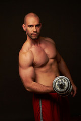 Muscular male body  black background
