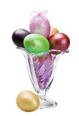 decorated easter eggs in a glass vase