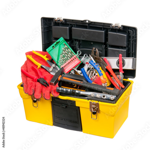Yellow, a plastic box filled with tools. Isolated.