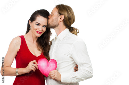 Beautiful couple in love holding love heart