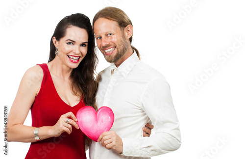 Happy couple holding love heart