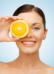 woman with orange slice