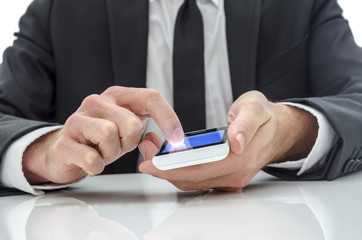 Businessman texting on a cell  phone