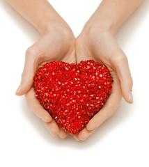 woman hands holding heart