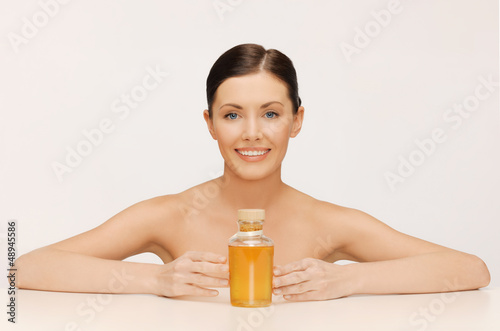 woman with oil bottle