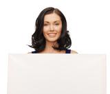 lovely woman in blue dress with blank board
